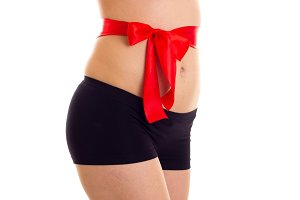 Woman's buttocks with red bowtie