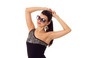Young woman in swimming suit with sunglasses