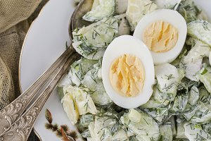 potato salad with egg, radishes and cucumbers