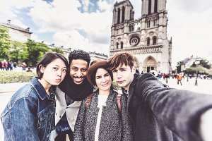 Multi-ethnic Group Of Friends Having Fun In Paris, Notre Dame