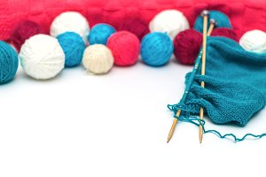 colorful woollen thread and knitting needles