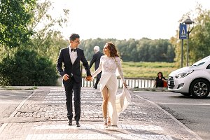 Stylish wedding couple walks