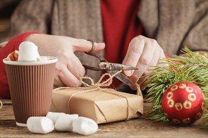 Adult man preparing gift