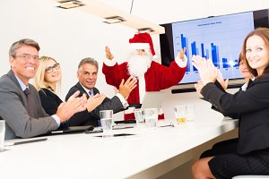 Serious Business Team Having A Conference With Santa