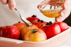 pouring honey on apple