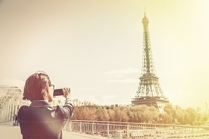 Tourist To Paris Taking Pictures Of The Eiffel Tower