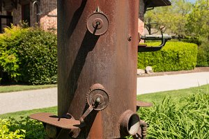 Old rusty metal wine press in Napa Valley