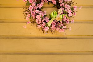 Pink flower wreath decorated for easter with bunny