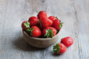 Strawberries in a wooden bowl.