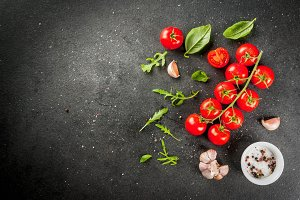 Cooking background: greens, tomatoes