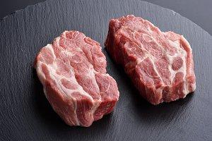 Fresh raw pork shoulder butt slices
