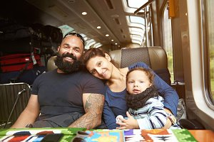 Modern young family travel in train