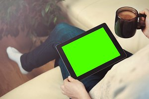 Woman Use Tablet Pc Sitting on Sofa