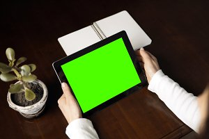 Woman Holds Tablet Pc with Green Screen