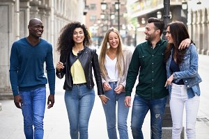 Young people smiling in the street