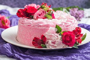 Pink cake with natural beautiful flowers