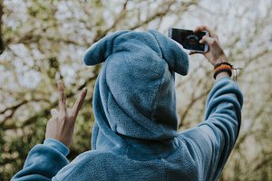 child dressed as taking pictures with your mobile phone