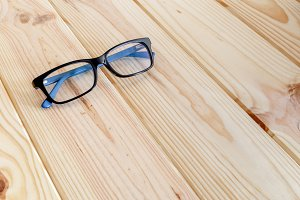 Glasses on wood table background