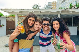Young people having fun in summer party outdoors