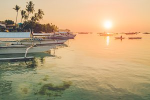 Sunset on the beach with silhouette of banca boat at Panglao Island, Bohol, Philippines