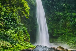 Amazing Nungnung waterfall, Big stone in front, Bali, Indonesia