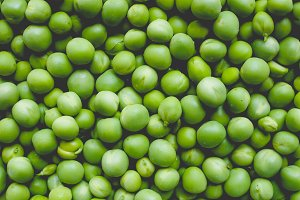 Green peas vegetable background, faded vintage look