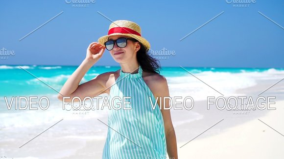 Beautiful Woman Smiling Happy On Summer Holidays On White Beach Happy Girl Walking In Summer Dress SLOW MOTION