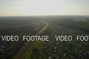 Aerial scene with countryside and moving train, Russia