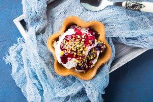 Vanilla ice cream with berry sauce