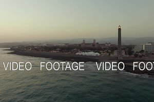 Aerial shot of Gran Canaria coast with lighthouse