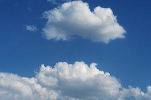 Clouds in clear blue sky