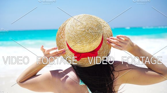 Back View Of Beautiful Woman In Hat On Summer Holidays On White Beach
