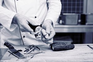 Chef is peeling cucumbers