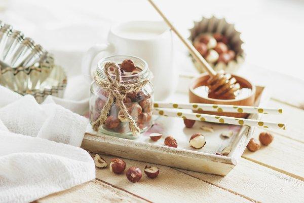 Honey in the wooden bowl, hazelnuts…