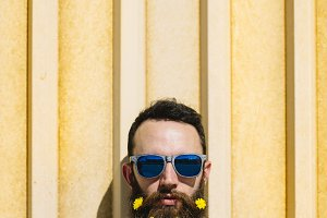 Man With Yellow Flowers in a Beard