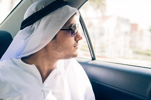 Young Arabian Man Sitting In The Car