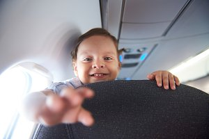 Smiling little boy travel in airlane