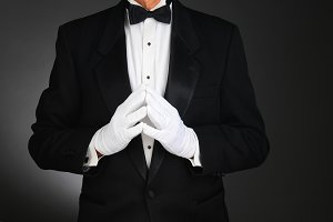 Man in Tuxedo with Hands in Front