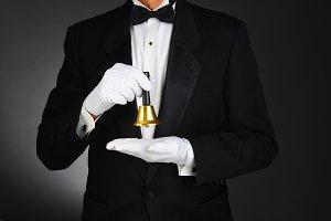 Butler Holding Service Bell