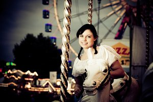 Young Woman Enjoying A Carousel Ride