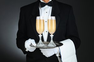 Sommelier with Champagne Glasses