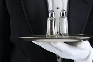 Waiter Holding Tray with Salt and Pe