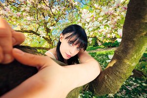 Young Woman In Magnolia Tree