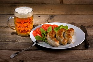 Glass of beer and sausages