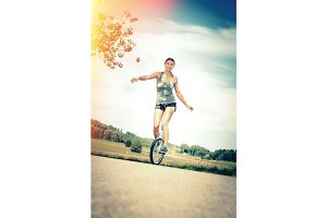 Young Woman Riding Her Unicycle
