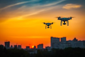 Two drone quad copters with high resolution digital camera flying
