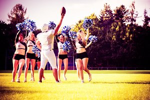 American Football Player With Cheerleaders