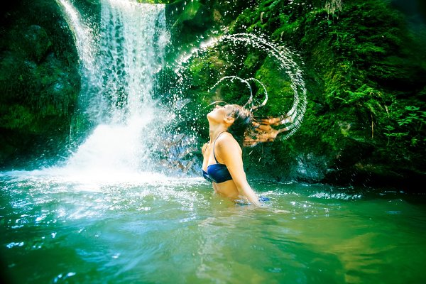 Beautiful Lady By The Waterfall
