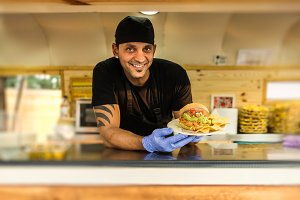 Smiling chef in a food truck