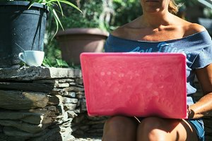 Unrecognizable woman surfing laptop